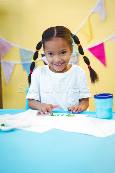 Smiling girl painting with her fingers Stock photo © wavebreak_media