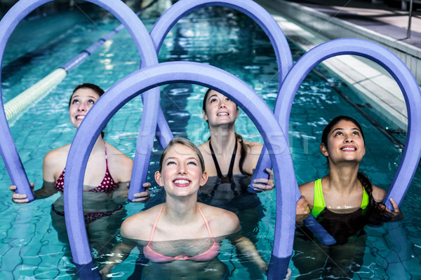 Feliz fitness classe água aeróbica espuma Foto stock © wavebreak_media
