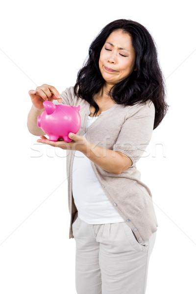 Heureux femme tirelire rose mains Photo stock © wavebreak_media