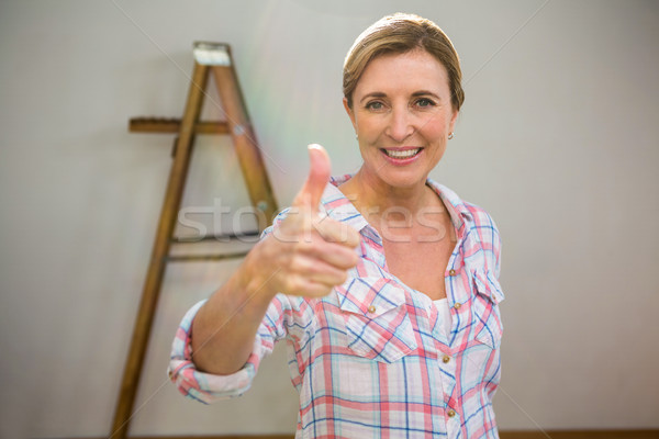 Woman with thumbs up Stock photo © wavebreak_media