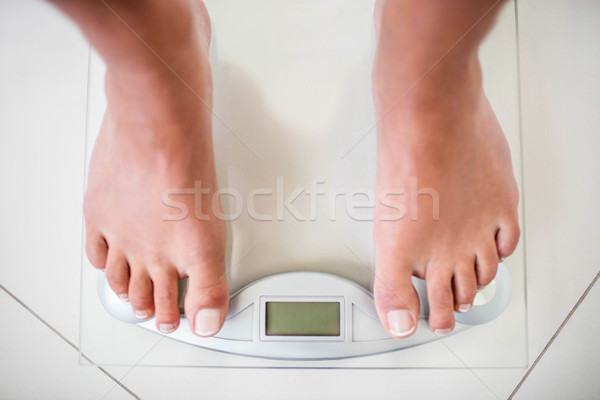 Feet of woman on weighting scale Stock photo © wavebreak_media