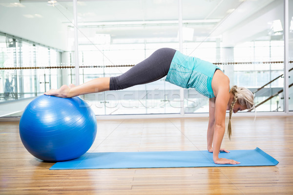 Fit blonde planking on mat with exercise ball Stock photo © wavebreak_media