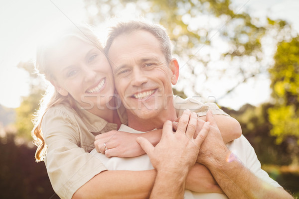 Cute couple with arms around each other Stock photo © wavebreak_media