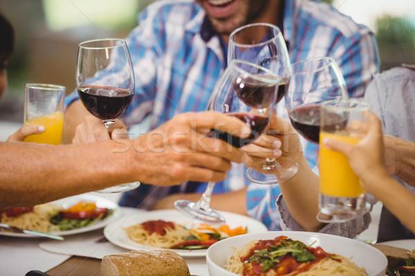 Família óculos vinho mesa de jantar comida Foto stock © wavebreak_media