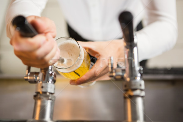 Masculine hands pouring a pint Stock photo © wavebreak_media
