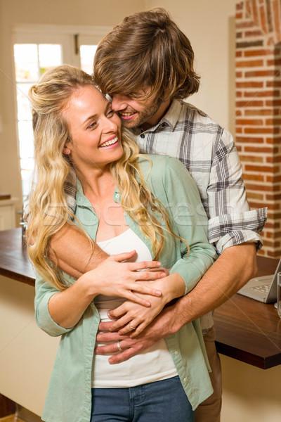 Cute couple hugging with arms around Stock photo © wavebreak_media