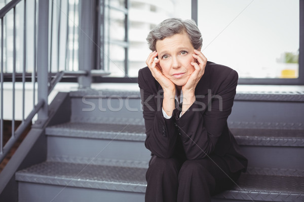 Thoughtful depressed businesswoman sitting on steps Stock photo © wavebreak_media