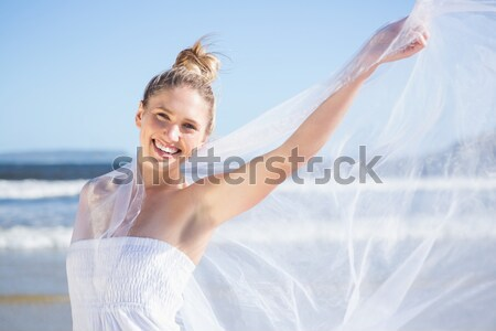 Blonde woman relaxing on the beach Stock photo © wavebreak_media
