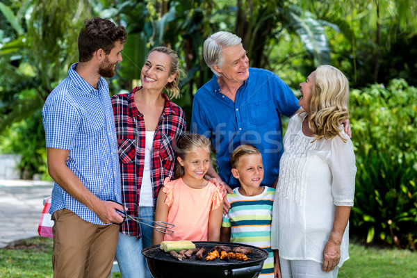 Front view of family griling food at yard  Stock photo © wavebreak_media