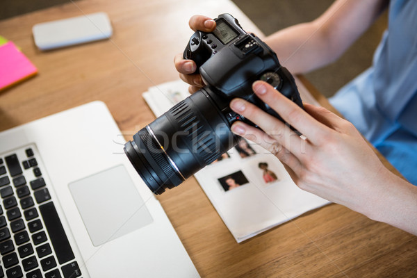 Close up of professional camera held by woman Stock photo © wavebreak_media