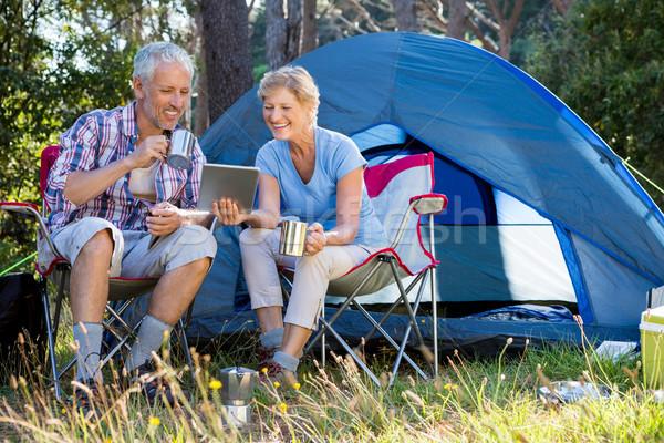 Senior couple relaxing beside their tent Stock photo © wavebreak_media