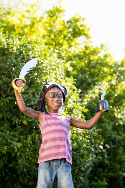 Chłopca ubieranie się w górę pirackich parku szczęśliwy Zdjęcia stock © wavebreak_media