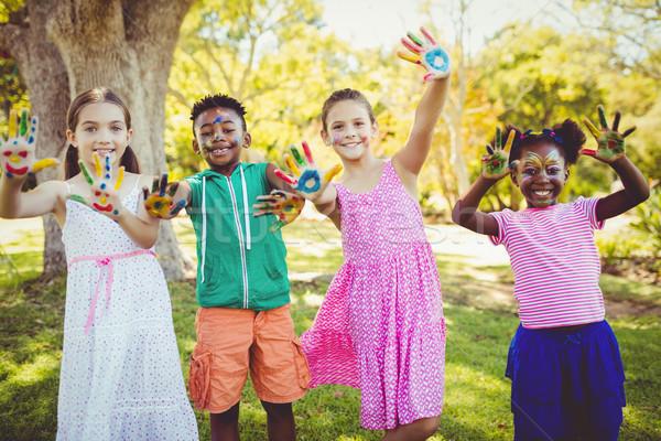 Stock fotó: Portré · aranyos · gyerekek · smink · kezek · park