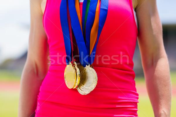 Középső rész női atléta arany medálok stadion Stock fotó © wavebreak_media
