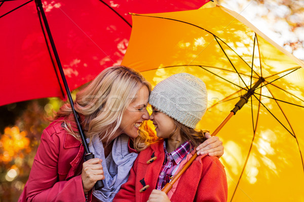 Cheerful mother and daughter with umbrella at park Stock photo © wavebreak_media