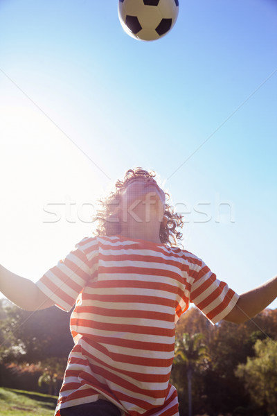 Low angle view of boy playing with soccer ball in park  Stock photo © wavebreak_media