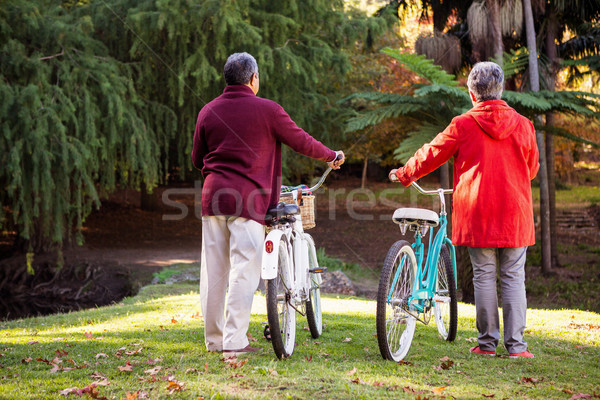 Couple with bicycle at park Stock photo © wavebreak_media