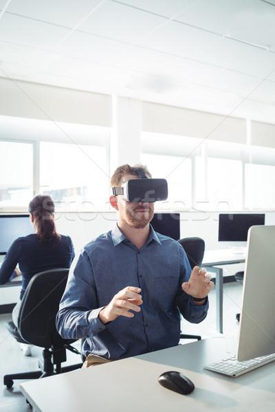 Mature student using virtual reality headset Stock photo © wavebreak_media