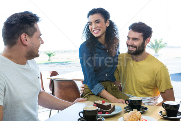 Friends interacting with each other in coffee shop Stock photo © wavebreak_media