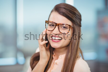 Smiling female optometrist wearing spectacles Stock photo © wavebreak_media