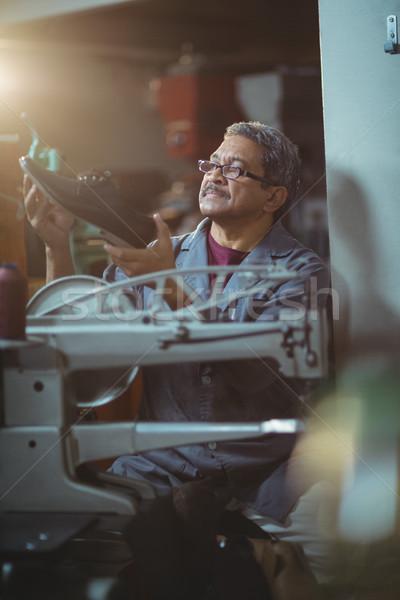 Shoemaker examining a shoe Stock photo © wavebreak_media