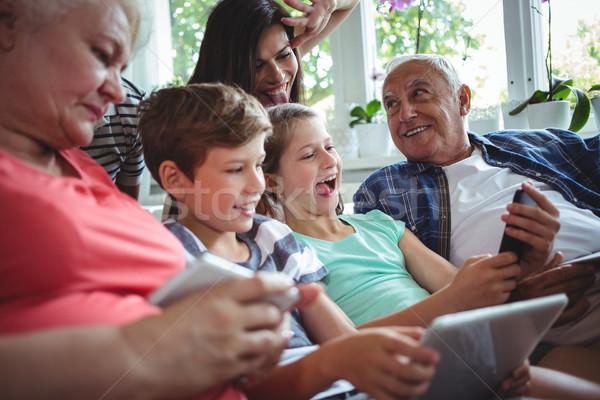 Happy multi-generation family sitting together in living room Stock photo © wavebreak_media