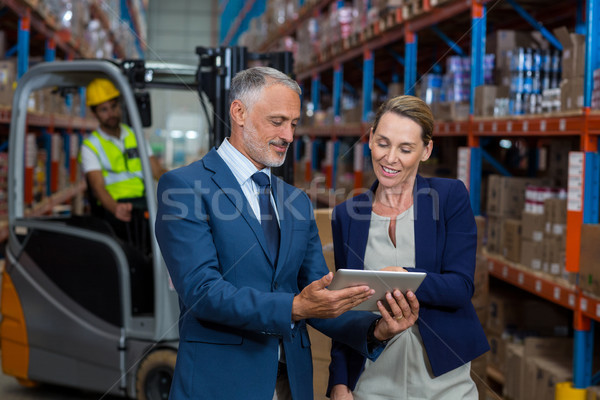 Warehouse manager and client discussing over digital tablet Stock photo © wavebreak_media