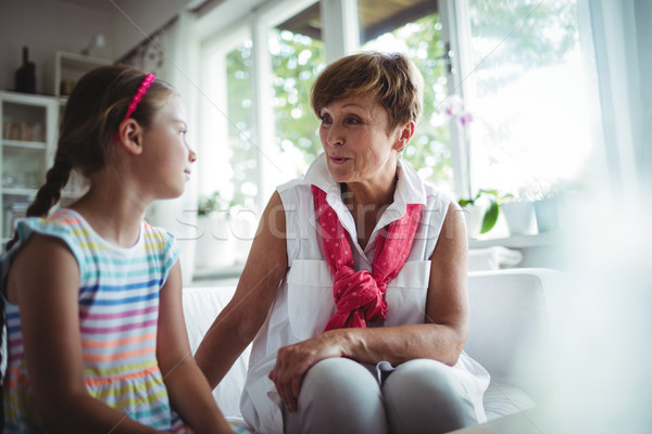 Senior woman and her granddaughter interacting with each other Stock photo © wavebreak_media