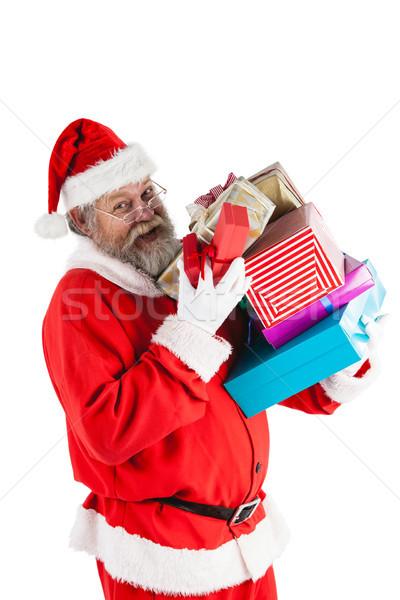 Portrait of santa claus holding a presents Stock photo © wavebreak_media