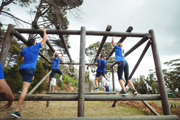 Fit people climbing monkey bars in bootcamp Stock photo © wavebreak_media