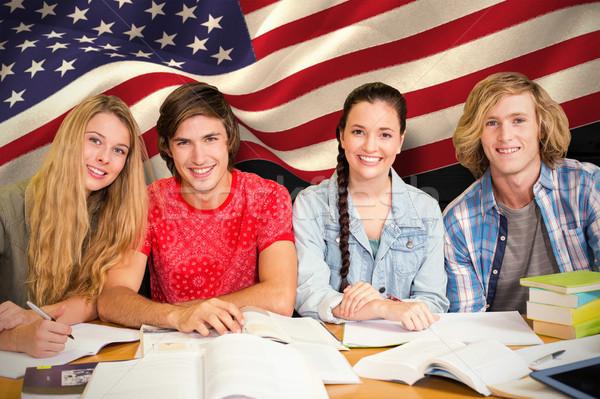 Composite image of college students doing homework in library Stock photo © wavebreak_media