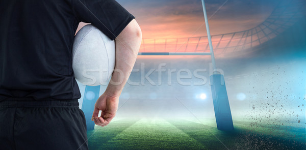 Composite image of rugby player holding a rugby ball Stock photo © wavebreak_media