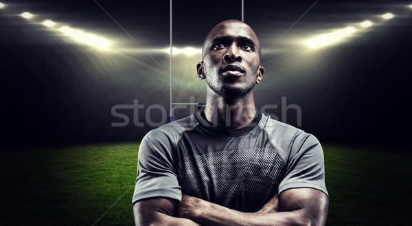 Composite image of thoughtful rugby player with arms crossed Stock photo © wavebreak_media