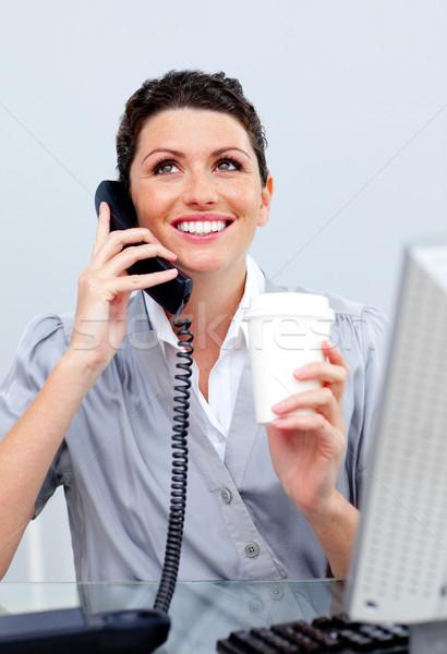 восторженный деловой женщины телефон питьевой кофе бизнеса Сток-фото © wavebreak_media