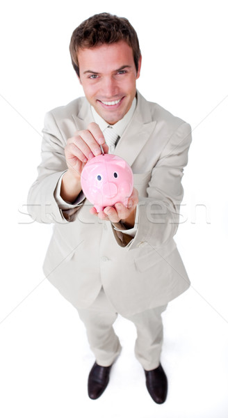 Charyzmatyczny biznesmen oszczędność ceny skarbonka biały Zdjęcia stock © wavebreak_media