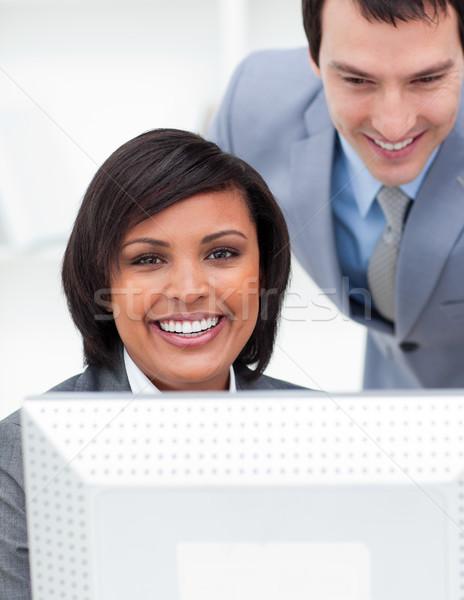 Kettő multikulturális kollégák dolgozik számítógép iroda Stock fotó © wavebreak_media