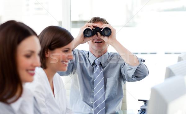 Carismático gerente olhando binóculo escritório negócio Foto stock © wavebreak_media
