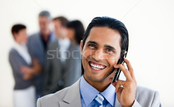 Fókusz tolakodó kisebbségi üzletember telefon fehér Stock fotó © wavebreak_media