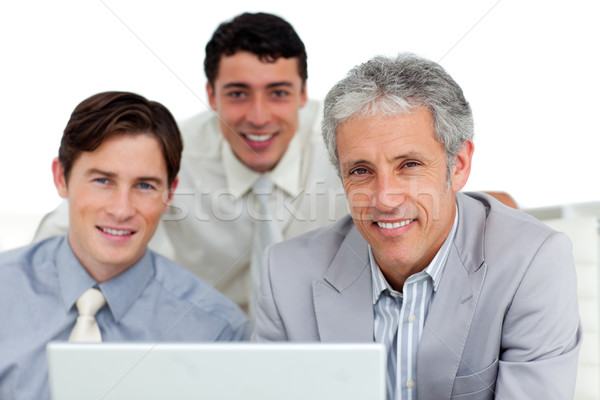 Self-assured business partners working at a computer  Stock photo © wavebreak_media