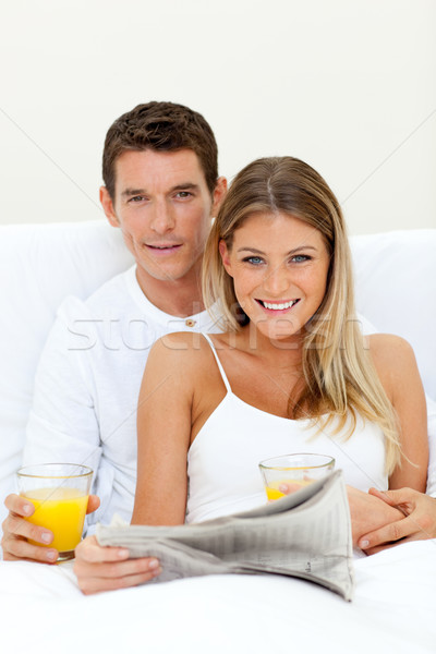 Young couple reading a newspaper and drinking orange juice Stock photo © wavebreak_media