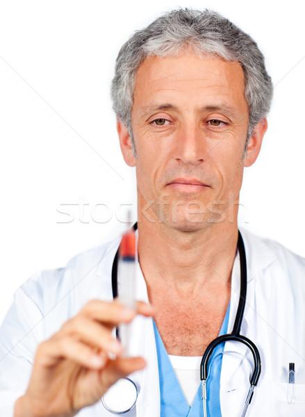 Sério médico seringa branco trabalhar Foto stock © wavebreak_media