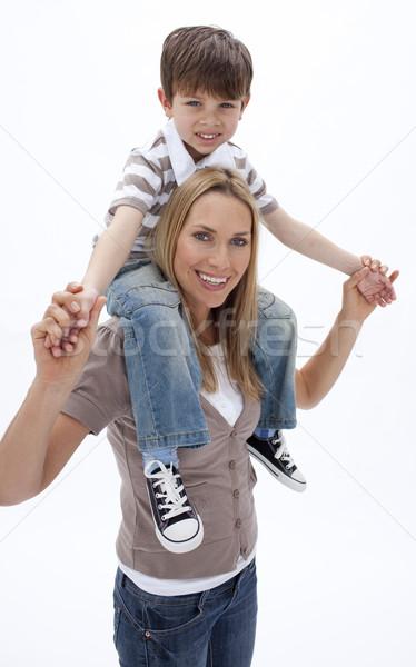 Vrouw weinig jongen op de rug Maakt een reservekopie Stockfoto © wavebreak_media