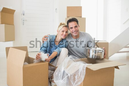 Delightedt couple with unpacking boxes moving to a new house Stock photo © wavebreak_media