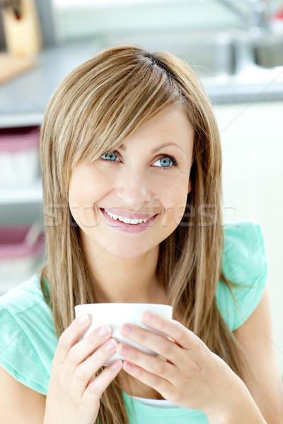 Kadın fincan kahve mutfak ev Stok fotoğraf © wavebreak_media