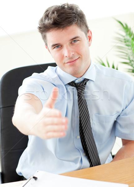 Karizmatikus üzletember tart ki kéz zárt Stock fotó © wavebreak_media