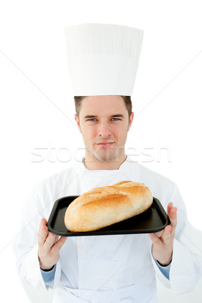 A male cook  holding bread looking at the camera against white background Stock photo © wavebreak_media