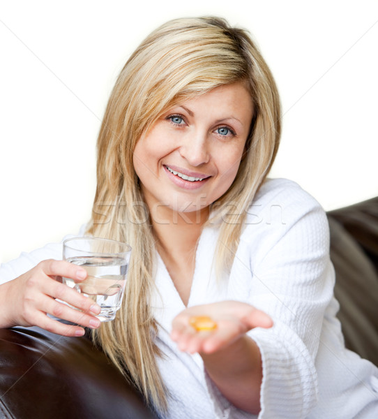Happy woman holding medicine Stock photo © wavebreak_media
