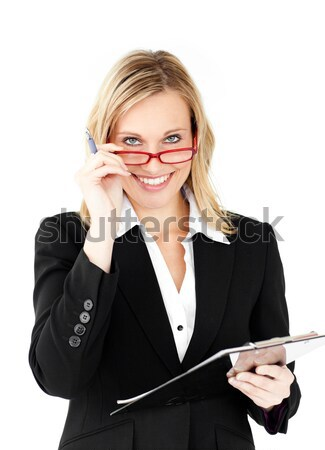 Self-assured businesswoman with folded arms against white background Stock photo © wavebreak_media