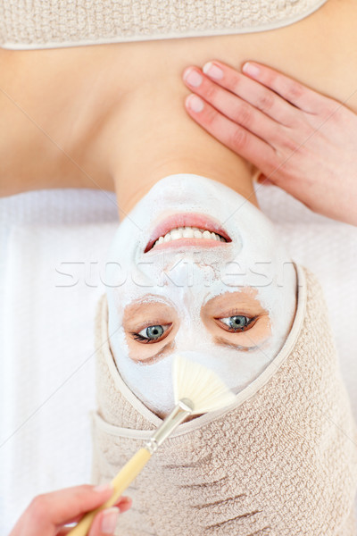 Captivating woman having white cream on her face in a spa Stock photo © wavebreak_media