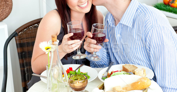 Close-up of a happy boyfriend kissing his beautiful girlfriend during dinner at home Stock photo © wavebreak_media
